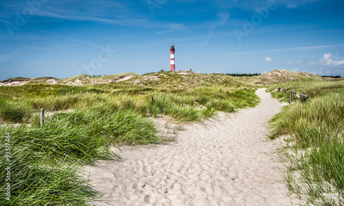 Deurstickers Noordzee Dune landscape with lighthouse at North Sea