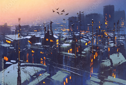 obraz miasta śnieżna zimowa scena, dachy pokryte śniegiem o zachodzie słońca