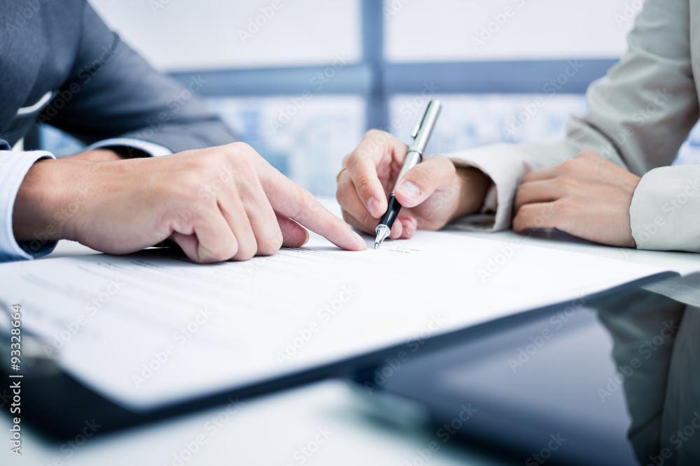 Fototapeta Female hand signing contract.