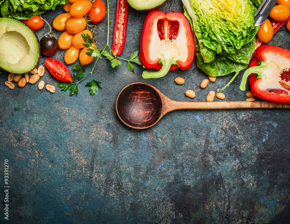 Colorful organic vegetables with wooden spoon , ingredients for salad