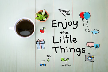 Enjoy the Little Things message with a cup of coffee