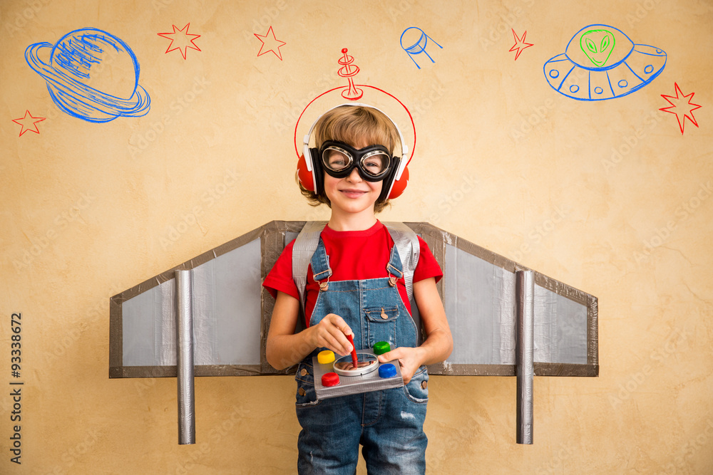 Fototapety, obrazy: Kid pilot with toy jetpack playing at home