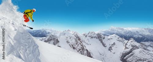 Obraz na plátně Jumping skier at jump
