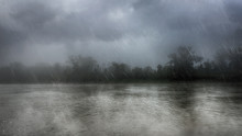 Heavy Rain Over A River