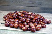 Many Chestnuts On A Wooden Table