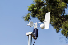 Anemometer And Devices Meteorological Station On The Blue Sky Ba