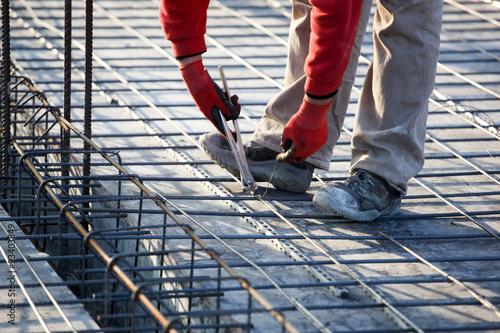 Fotografia, Obraz  workers make reinforcement for concrete foundation