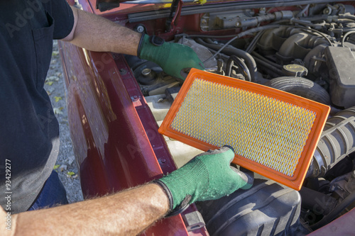 Photo  Mechanic With A New Air Filter