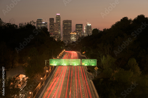 Photo  Los Angeles sunset highway traffic skyline