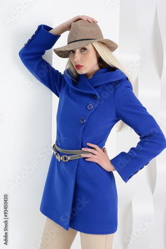 Fotografie, Obraz  Girls in coats posing at stidio