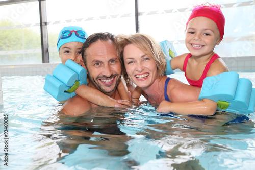 Fotografie, Obraz  Portrait of family having fun in public indoor swimming-pool