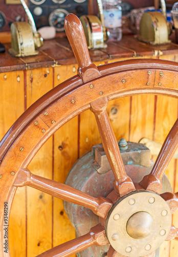 Old wooden ship's wheel. © dmitrimaruta