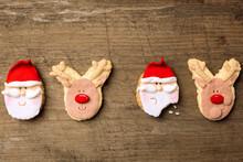 Funny Christmas Cookies Santa And Reindeer On Wood Background