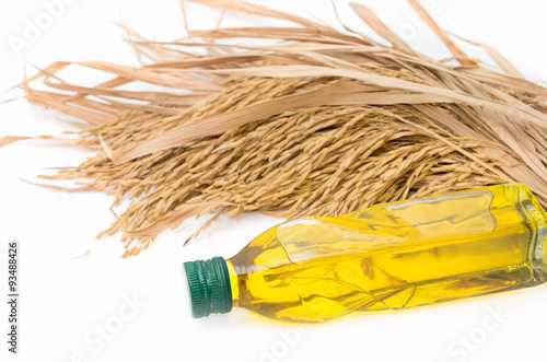 Valokuva  Rice bran oil in bottle glass with rice paddy on white
