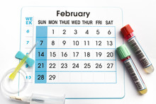 Blood Tubes And Needle On The Bottom Of An Appointment Calendar Of February 2016 / February 2016 Planning Calendar And Blood Samples In Tubes