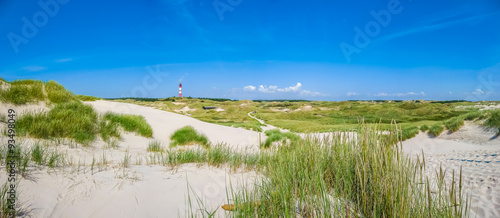 Spoed Foto op Canvas Noordzee Dune landscape with lighthouse at North Sea