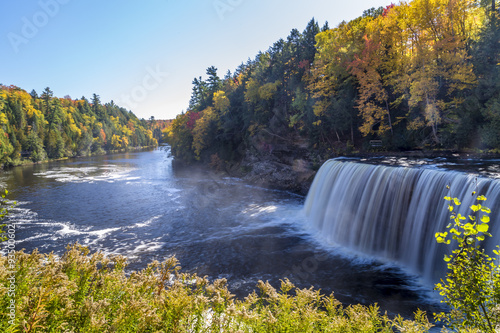 Fotografie, Obraz  Tahquamenon Falls in Michigan's eastern Upper Peninsula seen with colorful fall foliage