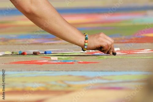 Madonnari- Street art with chalk, woman hand woman hand © FOTOALEM