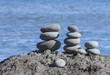 Stone on sand on the bank of Pacific ocean on Kamchatka