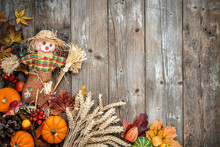 Colorful Autumn Background With A Scarecrow