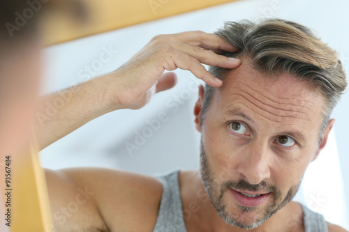Middle-aged man concerned by hair loss Wallpaper Mural