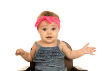 Cute Baby Girl Sitting In A Br...