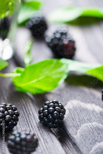 Fényképezés  Blackberry on wooden background