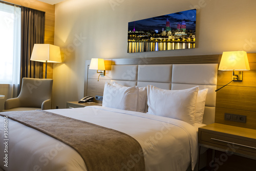 Beautiful hotel room with framed photo on the wall