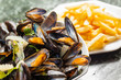 canvas print picture - Steamed mussels and French fries