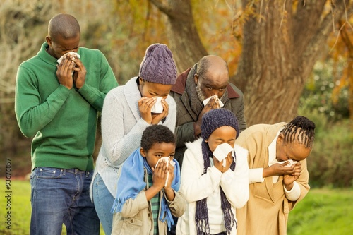 Fotografia  Sick family blowing their nose