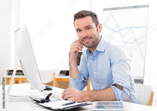 Garden Poster Young attractive businessman at the office