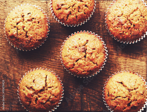 Fotografie, Obraz  Homemade carrot muffins on brown wooden background
