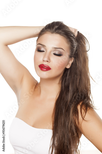 smiling beautiful young woman posing on a white Canvas Print