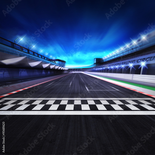 Staande foto F1 finish line on the racetrack in motion blur with stadium and spotlights