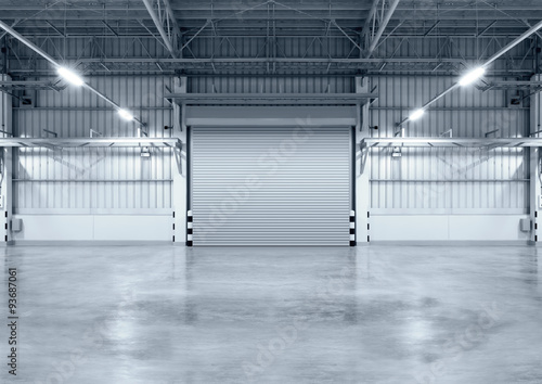 Roller door or roller shutter inside factory, warehouse or industrial building Wallpaper Mural