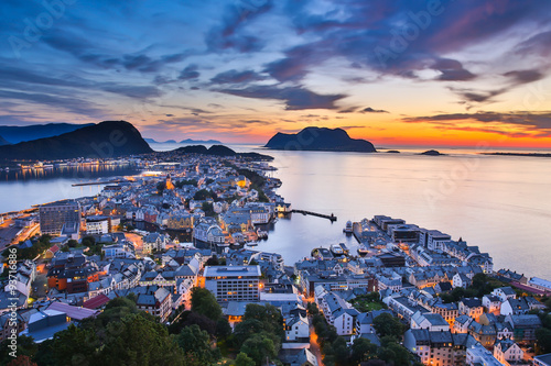 Top view of the city of Alesund at sunset . Norway