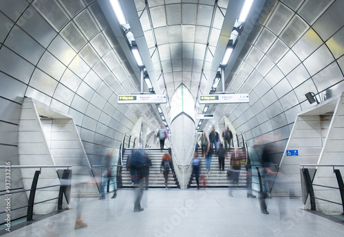 Travelers movement in tube train station, London..