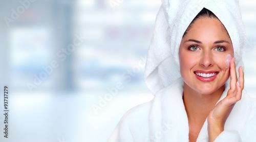 Fotografie, Obraz  Beautiful woman face with moisturising  cream.