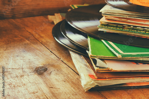 Fotografía  records stack with record on top over wooden table