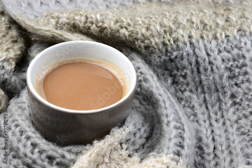 Canvas Prints Chocolate Hot chocolate in coffee mug cup with a grey, ivory, ecru knitted scarf blanked wrapped.around it and chocolate bar