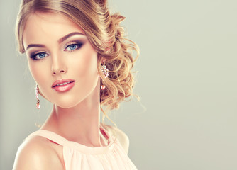 Beautiful model with  elegant hairstyle . Beautiful woman with fashion wedding hairstyle and colourful makeup
