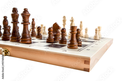 Photo  Chess board with chess wooden pieces isolated on white