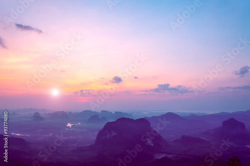 Tuinposter Zwart mountains under colorful sky in sunset