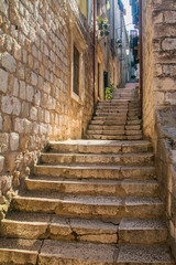 Fototapeta Narrow street and stairs in the Old Town in Dubrovnik, Croatia, Mediterranean ambient