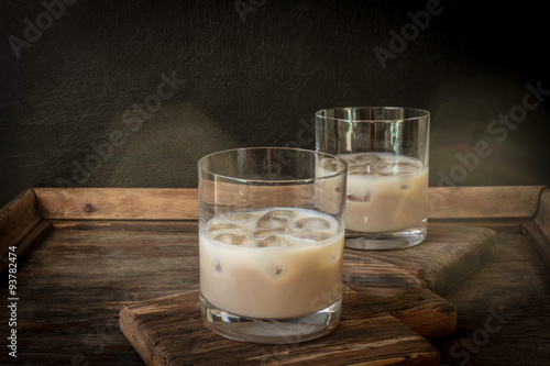 Irish cream liqueur in a glass with ice. Wallpaper Mural