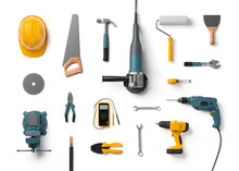 Helmet, Drill, Angle Grinder And Other Construction Tools On A W