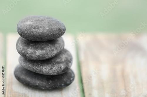 Deurstickers Stenen in het Zand Pebbles on wooden background