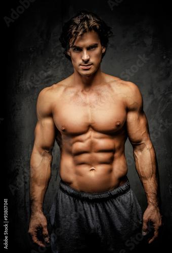 Awesome muscular man with great body. Obraz na płótnie