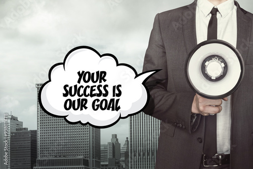Photo  Your success is our goal text on speech bubble with businessman