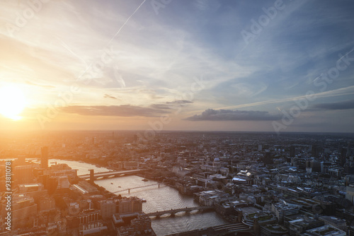Poster London London city aerial view over skyline with dramatic sky and landm